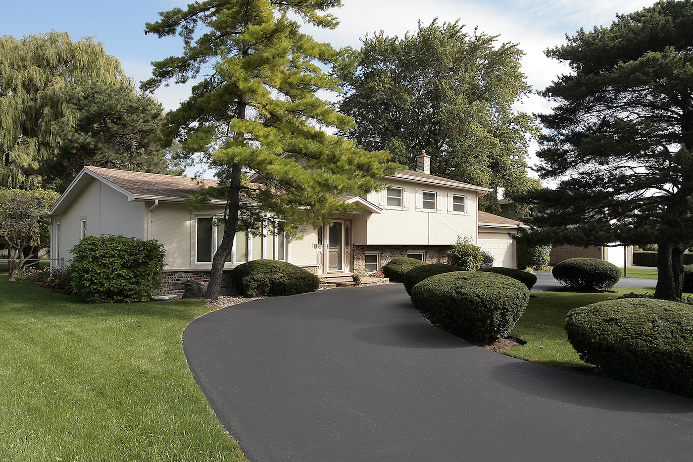 Asphalt-Sealing-Striping-Reeves-Construction-Roof-Gutters 1
