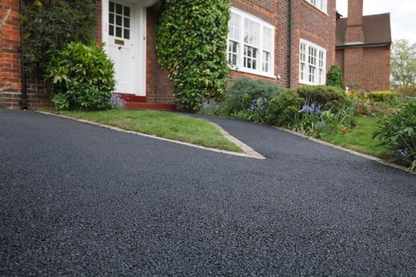 Asphalt-Sealing-Striping-Reeves-Construction-Roof-Gutters 2